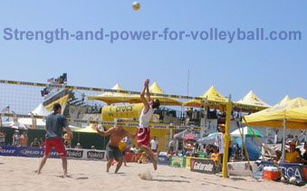 AVP beach volleyball spiking at the net