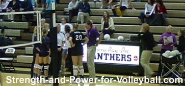 Volleyball officials communicating with teammates and scorekeeper