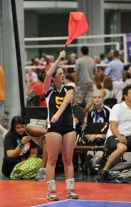 Volleyball line judge signaling server foot fault