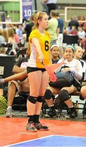 Volleyball line judge signaling ball in